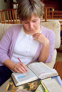 young woman studying scriptures