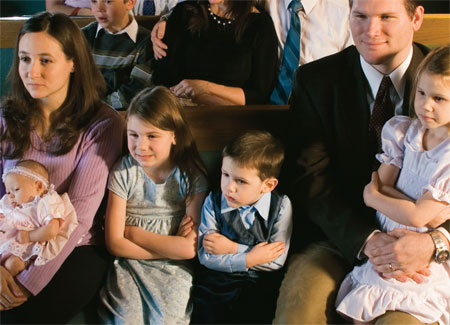 reverent family at church