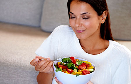 woman savoring salad