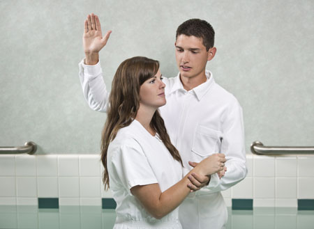 young woman being baptized