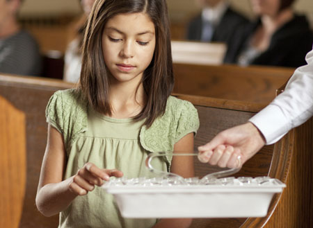 girl taking the sacrament