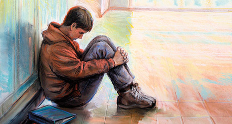 boy sitting in hallway