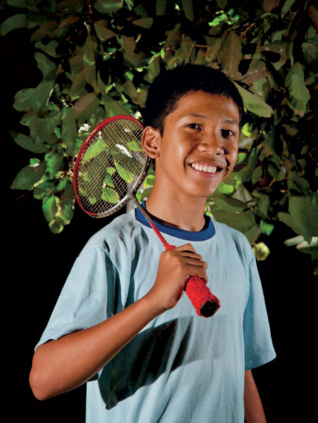 young man with badminton racquet