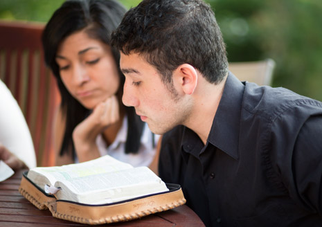 youth studying scriptures