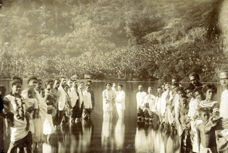 Missionaries baptize natives in Sandwich Islands (Hawaii)