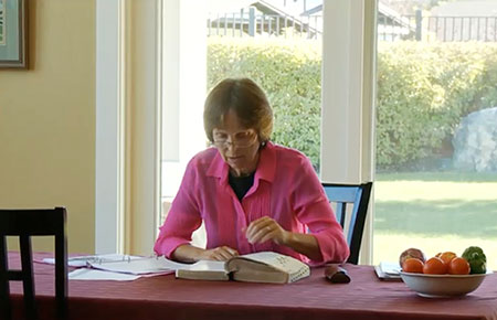Sister Durrant studying the scriptures