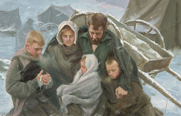 pioneer-family-kneeling-in-the-snow