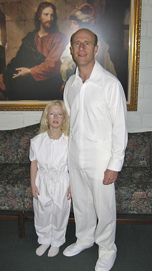 Brother Bairett and daughter at baptism