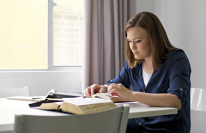 young adult woman studying scriptures