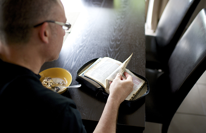 young adult man studing scriptures