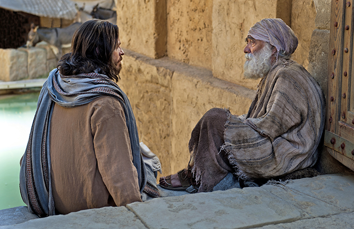 Jesus sitting with old man