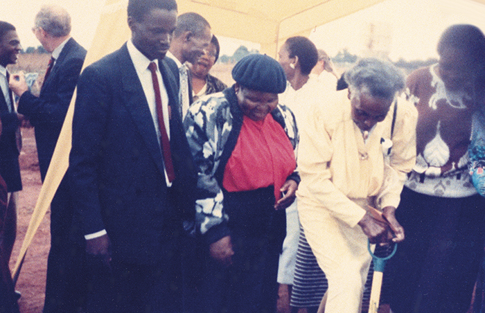 Julia Mavimbela participating in the groundbreaking of a new building