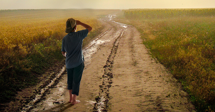 walking down a dirt road