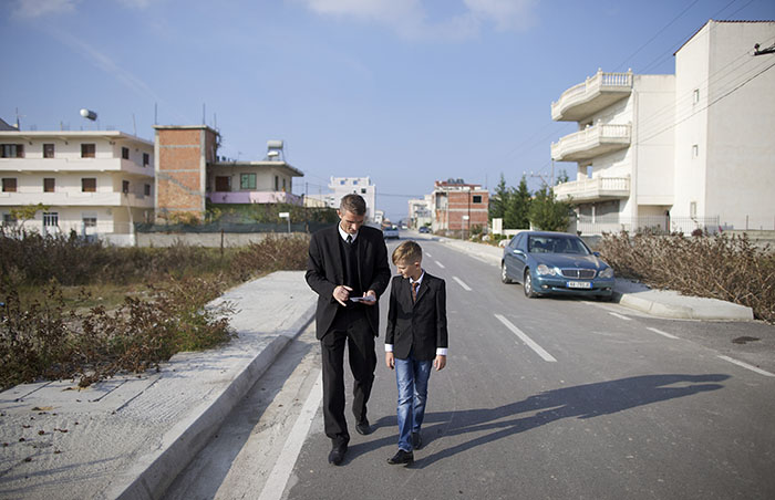 ilir walking with son