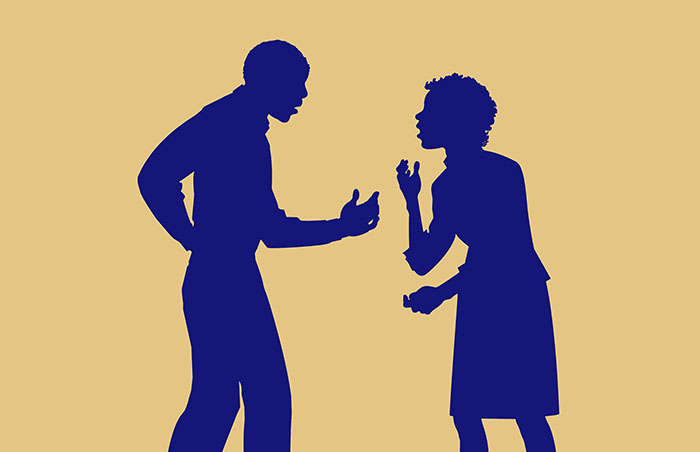 silhouette of couple arguing