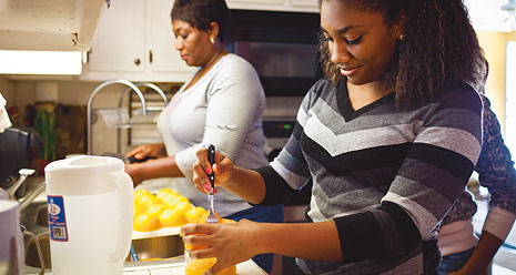 mother and daughter preparing fruit