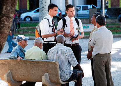 missionaries talking to group of men