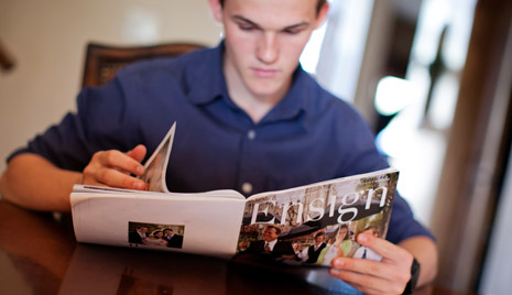 young man reading Ensign