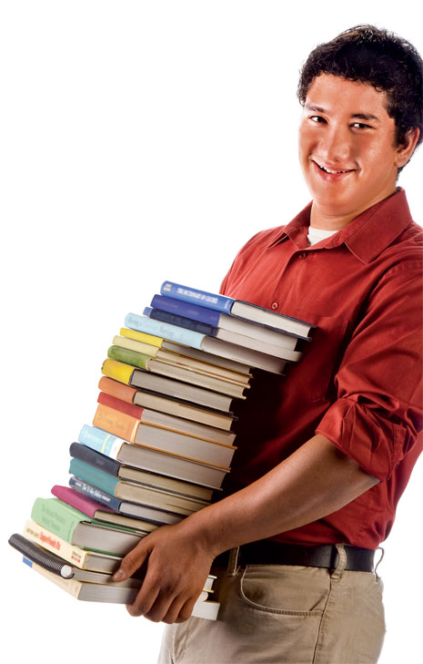 young man carrying stack of books