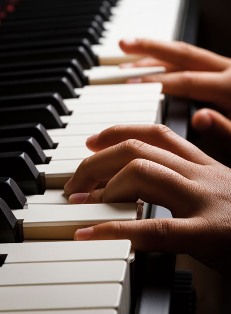 fingers on a piano keyboard