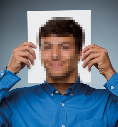 young man holding pixellated photo
