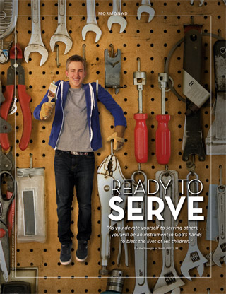 young man hanging on pegboard with tools