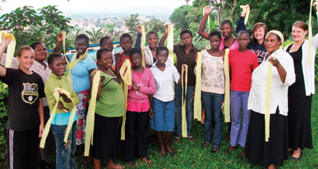 youth in Uganda holding yellow banners