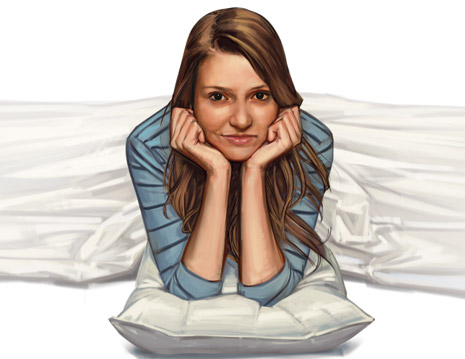 young woman propped on pillow