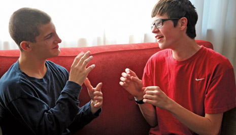 young men using sign language