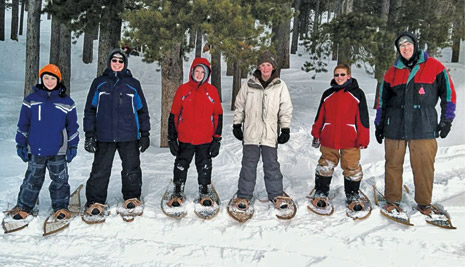 young men snowshoeing