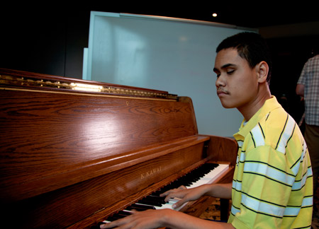 young man at piano