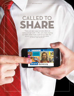 young man with mormon.org website on phone screen
