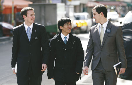young man with missionaries