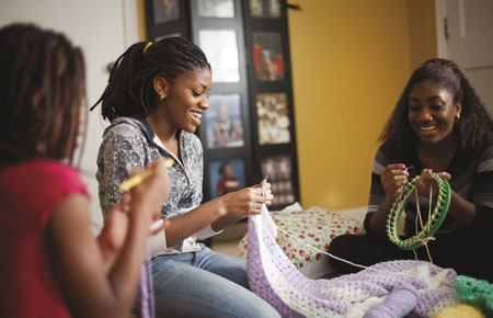 young women crocheting