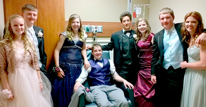 young man with friends in hospital