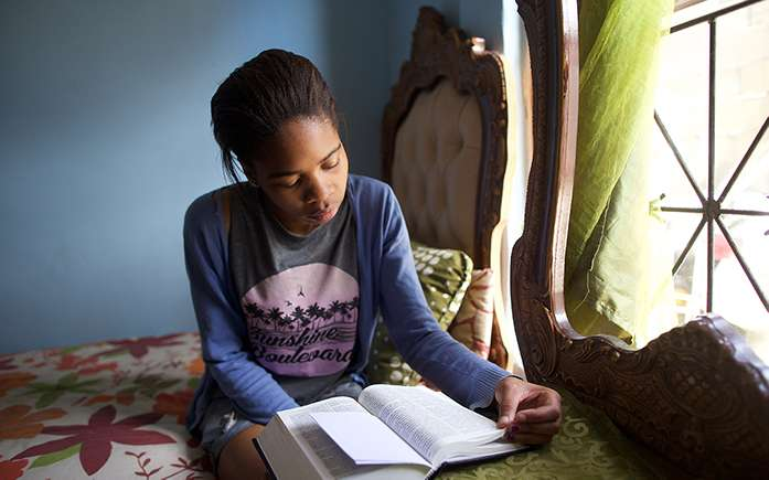 Young woman studying the scriptures