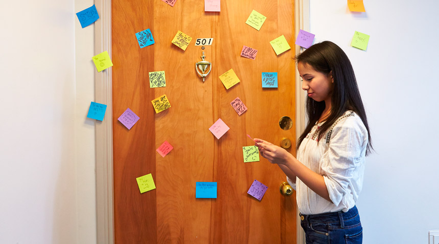 Young woman with post-it notes