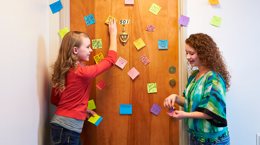 Young women with post-it notes